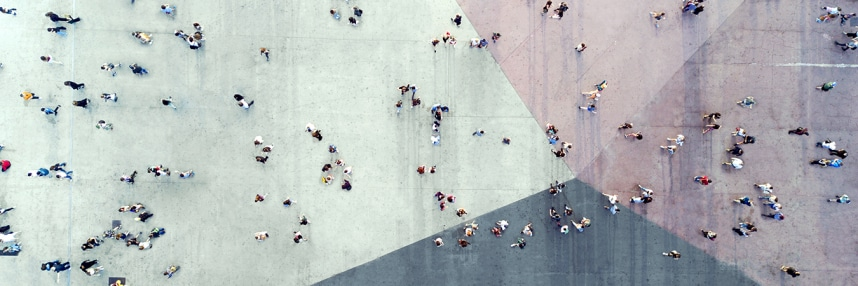Aerial photograph of a crowd walking across a plaza